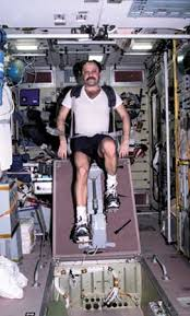 Russian Cosmonaut Yury V Usachyov Exercising On A Cycle Ergometer In The Strong