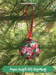 Supplies I Needed For This Project Were Various Scrapbook Papers In Christmas Patterns Colors Styrofoam Ball Glue Ribbon And A Paper Punch