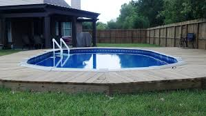 Countersunk Above Ground Pool With Deck... Gives The Feel Of An ... Coolest Backyard Pool Ever Photo With Astounding Decorating Create Attractive Swimming Outstanding Small Beautiful This Is Amazing Images Marvellous Look Shipping Container Pools Cost Youtube Best Homemade Ideas Only Pictures Remarkable Decor Diy Solar Heaters For Inground Swiming Stainless Fence Wood Floor Also Lap How Much Does It To Install A Hot Tub Near An Existing On Charming Landscaping Ideasswimming Design Homesthetics Custom Built On Your Budget Ewing Aquatech