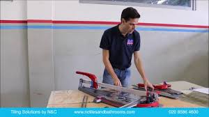 Kobalt Tile Saw Manual by How To Dry Cut Porcelain Tiles With A Manual Tile Cutter Youtube