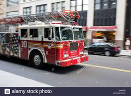 Fire Truck On The Street Of New York City - Engine 10 FDNY - Motion ... Hire A Fire Truck Ny Trucks Fdnytruckscom The Largest Fdny Apparatus Site On The Web New York Fire Stock Photos Images Fordpierce Snorkel Shrewsbury And 50 Similar Items Dutchess County Album Imgur Weis Trailer Repair Llc Rochester Responding Lights Sirens City Empire Emergency And Rescue With Water Canon Department Red Toy