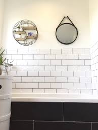 Grey Tiles With Grey Grout by White Metro Tiles And Grey Grout Circular Shelves And Mirror