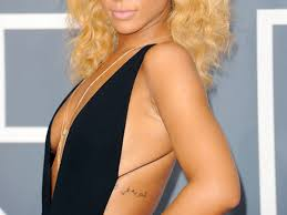 Rihanna With Arabic Tattoo On Side