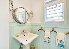 themed pedestals and powder room beach style with wainscoting
