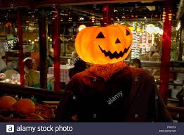 Weird And Spooky Pumpkin Man Outside Restaurant In The Tivoli Gardens Copenhagen On Dark Night Of Halloween