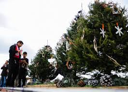 Sacred Heart Academy And Holy Name Of Jesus Catholics Hold A Christmas Tree Lighting Ceremony On Sunday To Celebrate The Churchs Move Its Future