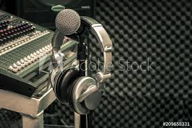 Close Up Instruments Music Background ConceptHeadphones Hang On Microphone With Sound Mixer Board In