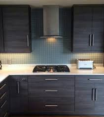 grey wenge wood cabinetry wirh modern and 2 square seafoam