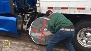 AutoSock A Snow Chain Alternative So Easy You Can Do It With One ... Risky Business Tire Repair Has Its Share Of Dangers Farm And Dairy Photo Gallery Tirechaincom Trucksuv Cable Chains Installation Youtube Top 10 Best For Trucks Pickups Suvs 2018 Reviews Semi Heavy Duty Truck Parts Over Stock Merritt Products Chain Carriers How To Install On A Driver Success Snow For Grip 4x4 Make Rc Truck Stop Hanger