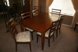 deliver a ethan allen dining table table leaf and 8 chairs to