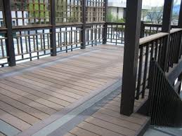 composite trex deck with inlay design and custom railing cfc