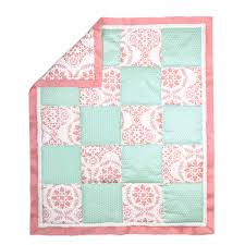 pretty patch medallion crib starter set in coral mint