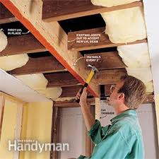 Installing Ceiling Joist Hangers by How To Install A Load Bearing Wall Beam Family Handyman