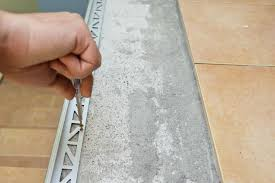 Cutting Schluter Tile Edging by Installing Tile Edging Howtospecialist How To Build Step By