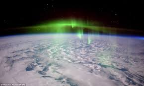 The International Space Station Passed Through A Thick Green Fog Of An Aurora As