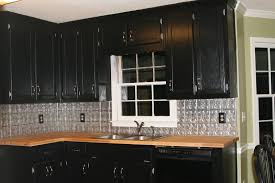 Cool Black Kitchen Cabinets With Tin Backsplash And Window Molding Also Laminate Countertops