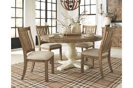 Grindleburg 60 Round Table 4 Chairs