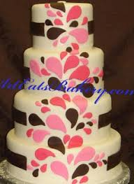 Custom five tier black and white photo wedding cake with pearls and pearl topper