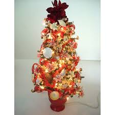 Tree Decorated With Poinsettias And Shells
