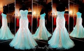 beautiful lace adorns this stunning mermaid prom dress its