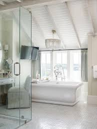 kohler vintage soaking tub with 19th c french empire crystal