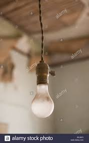 light fixture light bulb socket and bulb hanging stock photo