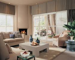 Transitional Living Room Sofa by Dining Room Cozy Gray Sofa With Norman Shutters And Beige Ottoman