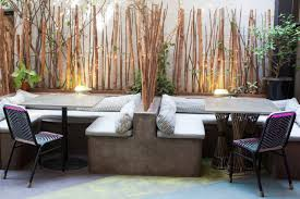 Booth Seating In The Patio Existing Tiled Walls Covered By Bamboo Sticks Photo Prarthna Singh