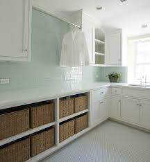 contemporary laundry room features white shaker cabinets and green