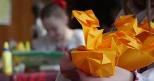 Girl In Vyshyvanka Makes Origami From Orange Paper Kids Make Contest Making Of Kusudama