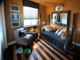 Bedroom Remarkable Orange Color Schemes On The Wall Design With Black Wooden Single Beds Frame And Gray Fabric Upholstered Armchair Above Striped