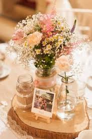 Pastel Rustic Table Centrepieces With Polaroid Photos As Names