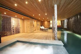 View In Gallery Luxurious Home Spa With Wooden Furnished Walls And Waterworks