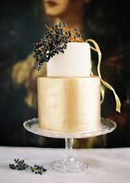 Elegant Gold Wedding Cake With Black Berries