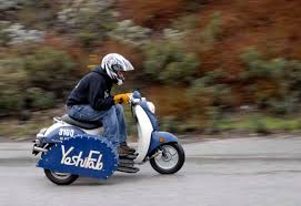 A Scooter With Sidecar Dodging The Raindrops