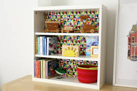 Decorating Bookshelves Without Books by How To Decoupage Paper Onto The Back Of A Shelf How Tos Diy
