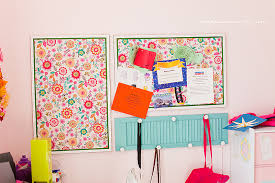 fabric covered pinboard in room at impressions by jani