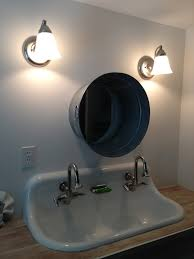 trough sink for bathroom with unique mirror and wall lighting
