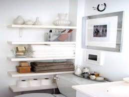 Diy Small Bathroom Storage Ideas With Framed Picture Above Toilet In White Themed