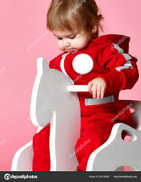 Toddler Baby Girl Is Riding Swinging On A Rocking Chair Toy ... Amazoncom Kids Teddy Bear Wooden Rocking Chair Red Delta Children Cars Lightning Mcqueen Mmax 3 In 1 Korakids Red Portable Toddler Rocker For New Personalized Tractor Childrens Pied Piper Toddler Great Little Trading Co Fisher Price Baby Chair Horse Baby On Clearance 23 X 14 22 Rideon Toys Whandle Plush Rideon Deer Gift Little Cute Haired Boy Sits Astride A Rocking Horse Pads Cushions Chairs Carousel Adirondack Starla Child Cotton