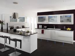 KitchenPerfect Modern White Kitchen With Dark Tile Floor And Small Breakfast Bar