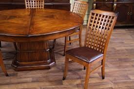 100 Birch Dining Chairs Solid Walnut Round Table With Self Storing Leaves
