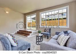 hallenraum in beige wände wohnzimmer mit modernem blauen