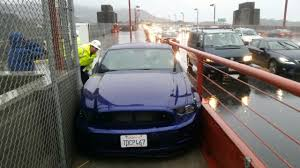 mustang drives on golden gate bridge sidewalk chp arrests