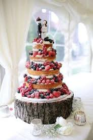 Fruity Naked Wedding Cake With Military Topper