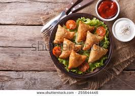 Samosa On A Plate With Sauce And Tomatoes Horizontal View From Above Rustic Style