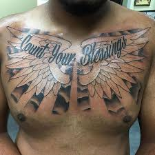 Black Ink Angel Wings Tattoo Design Made On Men Chest