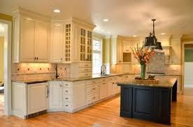 open kitchen features custom paint glaze wall cabinets an