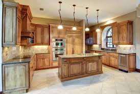 Contemporary Kitchen With Wood Island Tile Flooring And Decorative Pendant Lights