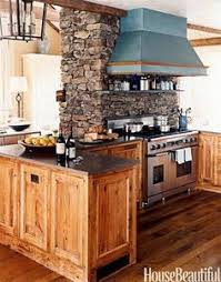 A Massive Stone Chimney Ties The Kitchen To Family Room While Shielding It From View